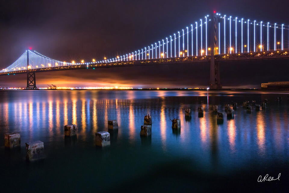 The Bay Bridge Illuminated At Night.
