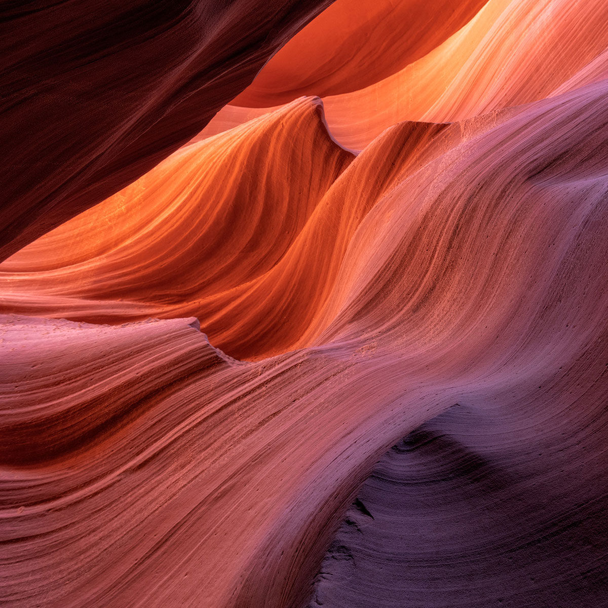 A photograph of abstract patterns found inside Antelope Canyon titled Deamweaver.