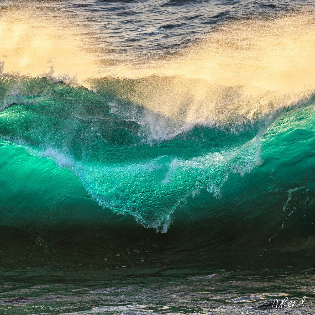 A fine art photograph of an emerald colored crashing wave in Big Sur, California.