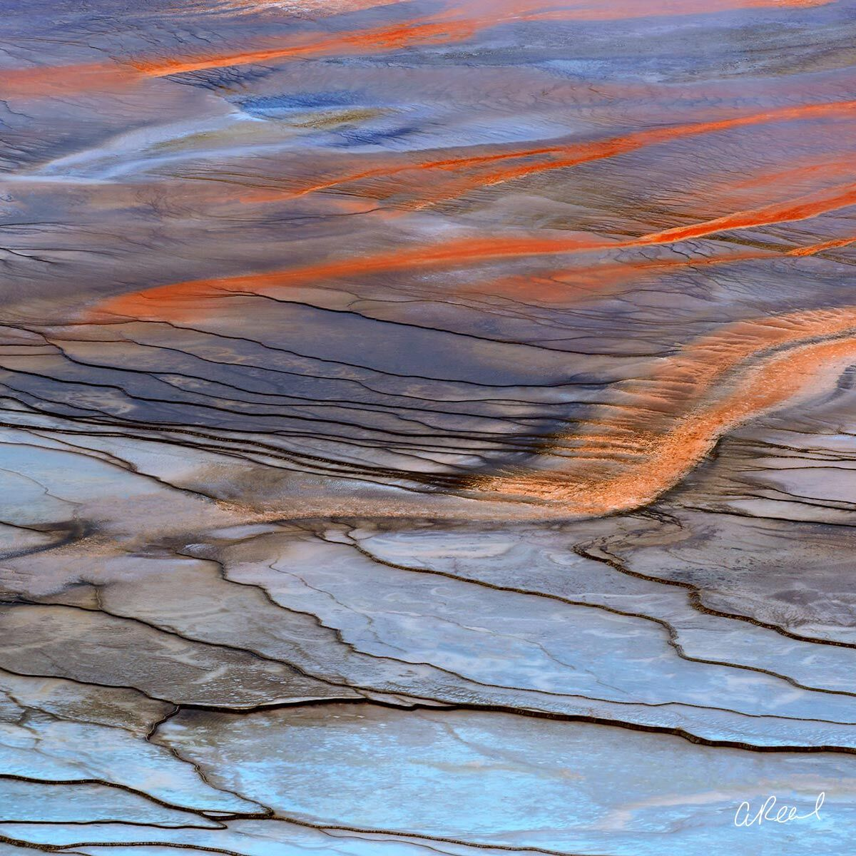 A fine art photograph of a geothermal spring in Yellowstone National Park titled Painted With Fire.