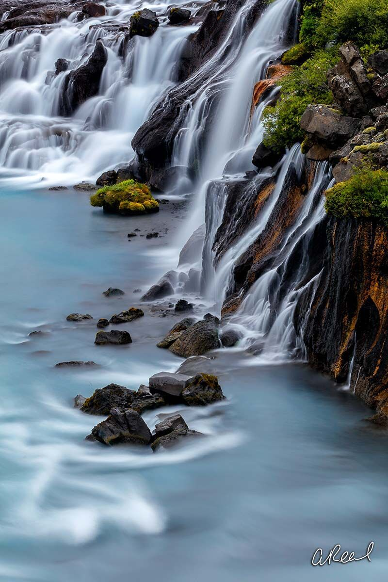 Transform your space with Aaron Reed's limited edition photography print, Hraunfossar Blues, from his Iceland Nature Photography...
