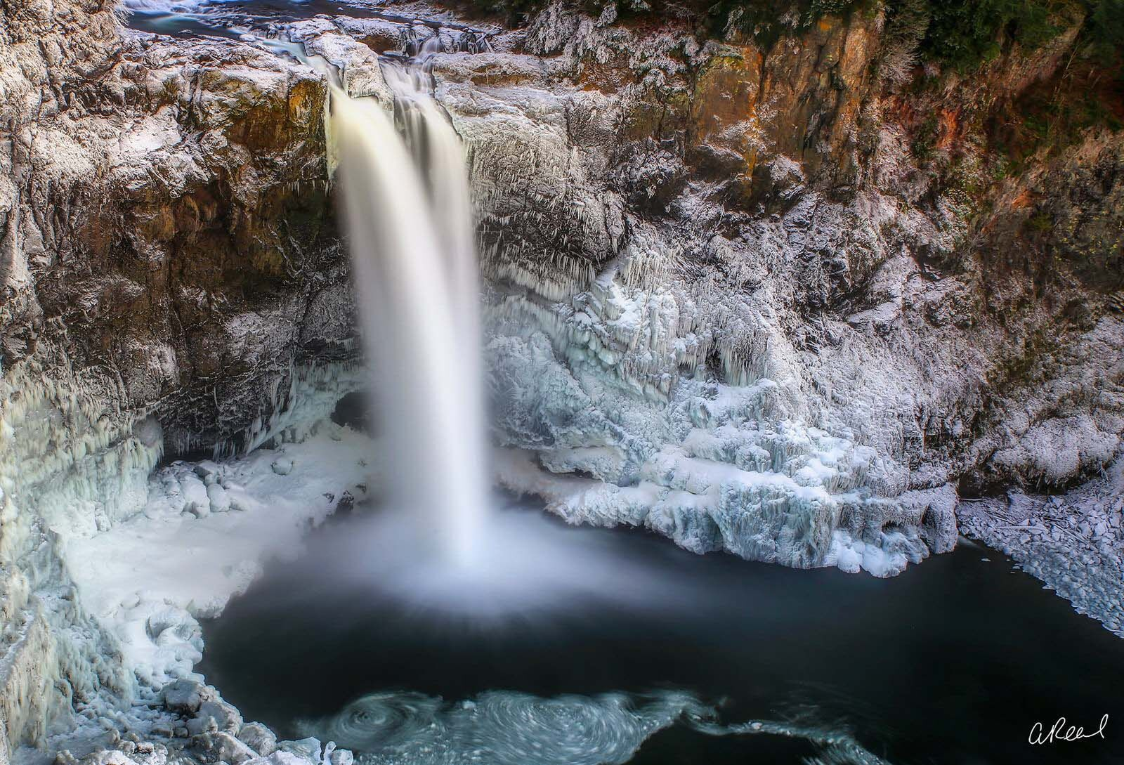 Create a window into nature with Aaron Reed's fine art photography print, Icebreaker, from his world of waterfalls collection...